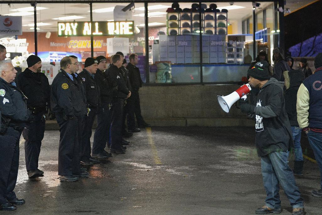 Arrests in protest over police shooting of black teen