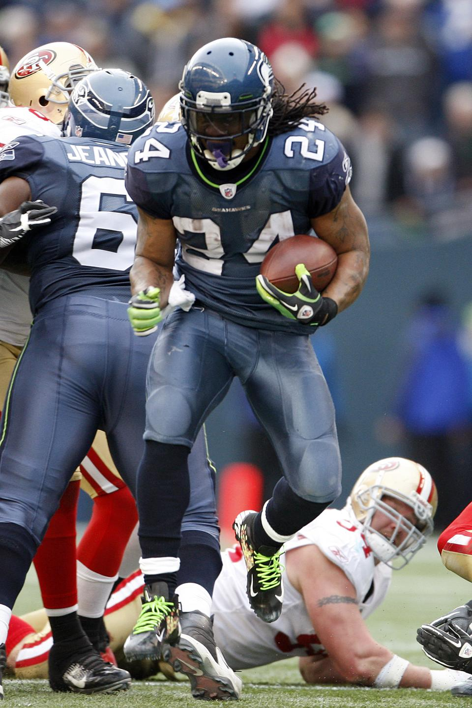 Seattle Seahawks' Marshawn Lynch rushes against the San Francisco 49ers in the first half of an NFL football game, Saturday, Dec. 24, 2011, in Seattle. (AP Photo/Kevin Casey)