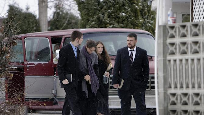 Family members of confessed serial killer Israel Keyes enter a funeral home, Sunday, Dec. 9, 2012, in Deer Park, Wash. Keyes confessed to killing eight people across the country before he committed suicide recently in a jail cell in Anchorage, Alaska. (AP Photo/Young Kwak)