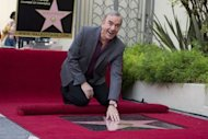 US singer-songwriter Neil Diamond receives a star on the Hollywood Walk of Fame outside the Capitol Records Building in California on August 10. Diamond, whose career has spanned five decades, has sold over 125 million albums worldwide