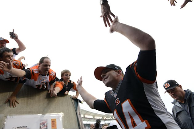 Cincinnati Bengals quarterback Andy Dalton leaves the field after his team defeated the New York Giants 31-13 in an NFL football game on Sunday, Nov. 11, 2012, in Cincinnati. (AP Photo/Michael Keating