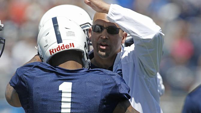 Penn State head coach James Franklin, right, greets running back Bill Belton (1) during warmups before the annual Blue-White NCAA college football scrimmage on Saturday, April 12, 2014, in State College, Pa