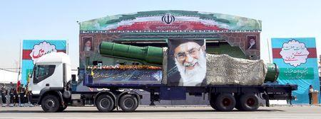 Military truck carrying a missile and a picture of Iran's Supreme Leader Ayatollah Ali Khamenei is seen during a parade marking the anniversary of the Iran-Iraq war (1980-88), in Tehran