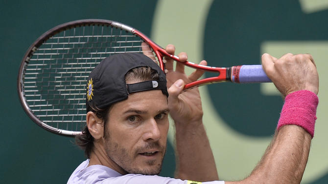 Germany's Tommy Haas  returns the ball during his semifinal tennis match against Switzerland's Roger Federer at the ATP Gerry Weber Open tornament in Halle, Westphalia, Germany, Saturday, June 15, 2013. (AP Photo/Martin Meissner)