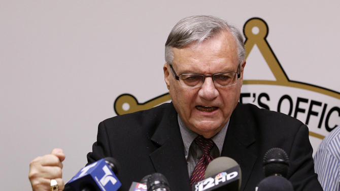 FILE - In this May 10, 2012 file photo, a defiant Maricopa County Sheriff Joe Arpaio pounds his fist on the podium as he answers questions regarding the Department of Justice announcing a federal civil lawsuit against Arpaio and his department, during a news conference in Phoenix.  For six years, the self-proclaimed toughest sheriff in America has vehemently denied allegations that his deputies racially profile Latinos in his trademark immigration patrols. Now, Arpaio will have to convince a federal judge who is presiding over a lawsuit that heads to trial on Thursday, July 19, 2012 and is expected to last until early August. (AP Photo/Ross D. Franklin, File)