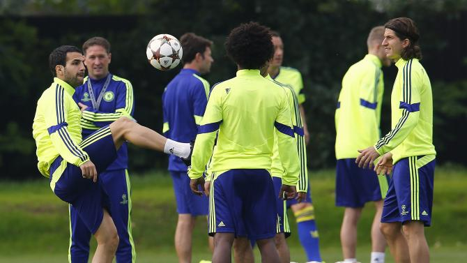 Chelsea's Fabregas controls the ball during a training session in Cobham