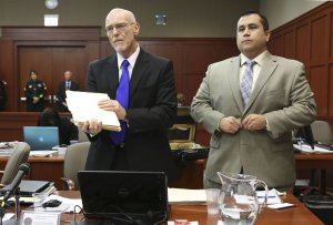 George Zimmerman, right, stands next to one of his …