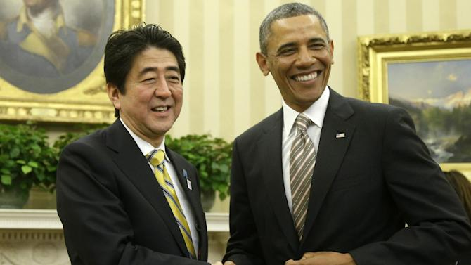 President Barack Obama shakes hands with Japan's Prime Minister Shinzo Abe in the Oval Office of the White House in Washington, Friday, Feb. 22, 2013. (AP Photo/Charles Dharapak)