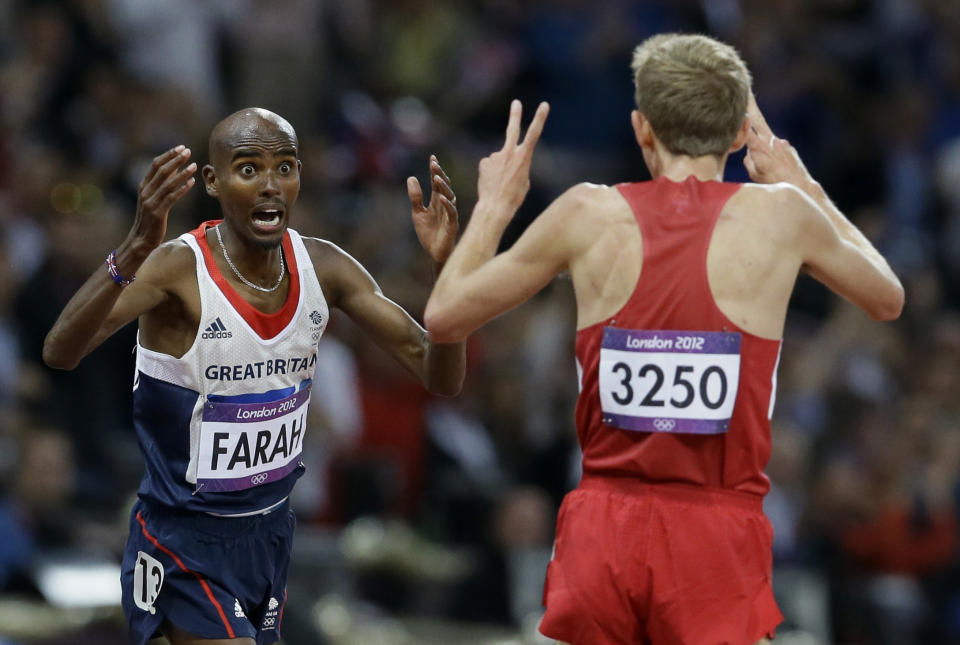 Britain's Mo Farah, left, reacts after winning gold ahead of United States' Galen Rupp, right, in the men's 10,000-meter final during the athletics in the Olympic Stadium at the 2012 Summer Olympics, London, Saturday, Aug. 4, 2012. (AP Photo/Kirsty Wigglesworth)