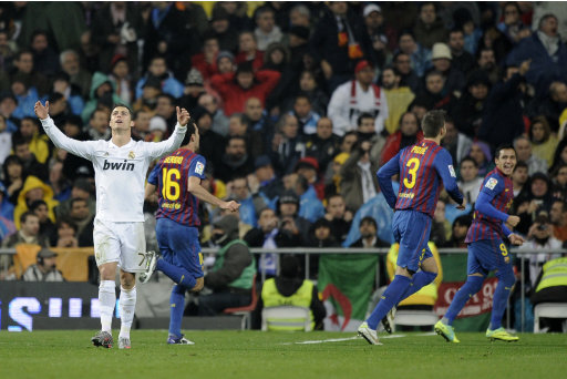 Real Madrid's Cristiano Ronaldo from Portugal, left, reacts during his Spanish La Liga soccer match after Barcelona's team scored a goal in the Bernabeu stadium in Madrid, Saturday, Dec. 10, 2011. (AP Photo/Daniel Ochoa de Olza)