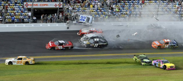 NASCAR driver Kyle Larson and his Chevrolet end up in the fence during the final lap crash during the NASCAR Nationwide Series DRIVE4COPD 300 race at the Daytona International Speedway in Daytona Beac