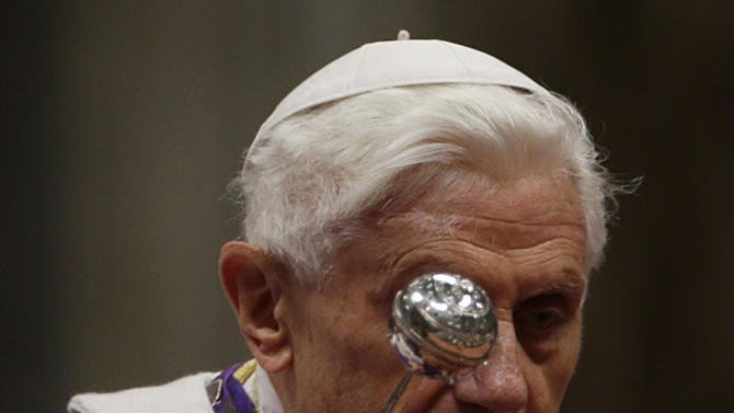 """Pope Benedict XVI blesses the ashes as he celebrates the Ash Wednesday mass in St. Peter's Basilica at the Vatican, Wednesday, Feb. 13, 2013.  Ash Wednesday marks the beginning of Lent, a solemn period of 40 days of prayer and self-denial leading up to Easter. Pope Benedict XVI told thousands of faithful Wednesday that he was resigning for """"the good of the church"""", an extraordinary scene of a pope explaining himself to his flock that unfolded in his first appearance since dropping the bombshell announcement. (AP Photo/Gregorio Borgia)"""