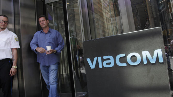 In this Aug. 3, 2011 photo, a man walks out of the Viacom headquarters, in New York. Viacom says, Friday, Aug. 3, 2012, its net income fell 7 percent in the latest quarter as advertising revenue declined more than expected, and its movie releases failed to measure up to last year's. (AP Photo/Mark Lennihan)