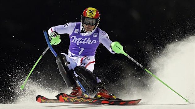 Marcel Hirscher of Austria clears a gate during the first run in the men's World Cup slalom race in Madonna di Campiglio