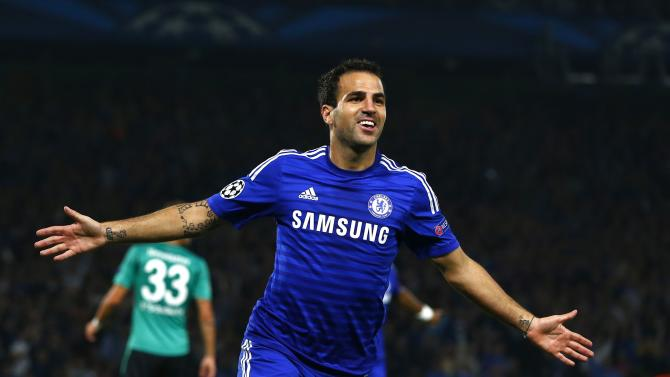 Chelsea's Fabregas celebrates after scoring a goal against Schalke 04 during their Champions League soccer match against at Stamford Bridge in London