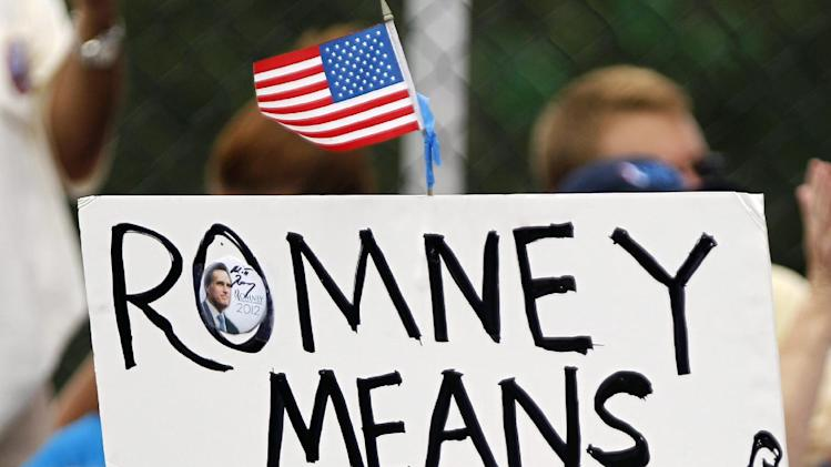 A man holds a sign before a campaign rally for Republican presidential candidate and former Massachusetts Gov. Mitt Romney, Sunday, Oct. 7, 2012 in Port St. Lucie, Fla. (AP Photo/Lynne Sladky)