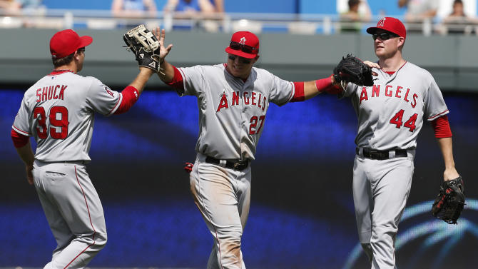 Los Angeles Angels center fielder Mike Trout (27) celebrates with left fielder J.B. Shuck (39) and right fielder Mark Trumbo (44) following a baseball game against the Kansas City Royals at Kauffman Stadium in Kansas City, Mo., Saturday, May 25, 2013. The Angels defeated the Royals 7-0. (AP Photo/Orlin Wagner)