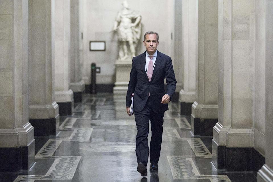 Mark Carney, the new Governor of the Bank of England, walks to a monetary policy committee (MPC) briefing on his first day on the job inside the central bank's headquarters in London Monday July 1, 2013. (AP Photo/Jason Alden/Pool)