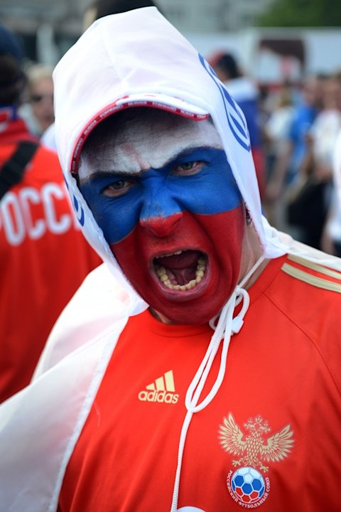 A Russian Football Fan Shouts …