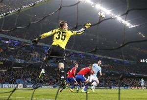 Manchester City's Negredo heads to score his third goal against CSKA Moscow during their Champions League soccer match at the Etihad Stadium in Manchester