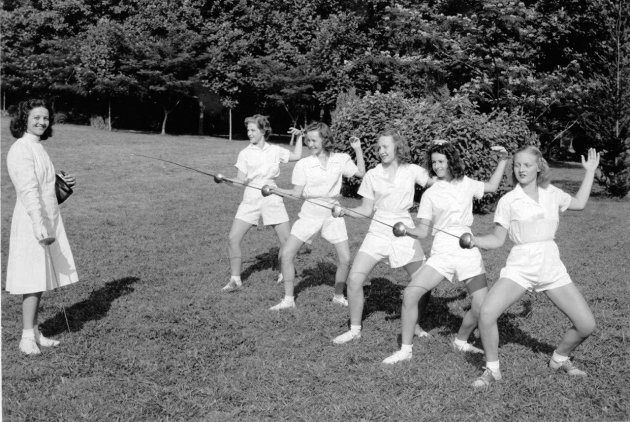 This undated photo released by Camp Greystone shows girls wearing uniforms while fencing at Camp Greystone in Tuxedo, N.C.  Of 361 camps surveyed recently by the American Camp Association, about 71 pe