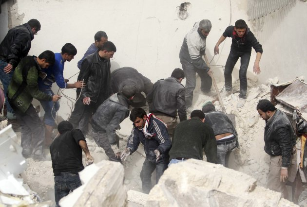 People search for casualties under the rubble at a site hit on Friday by what activists said was a Scud missile in Aleppo's Ard al-Hamra neighbourhood
