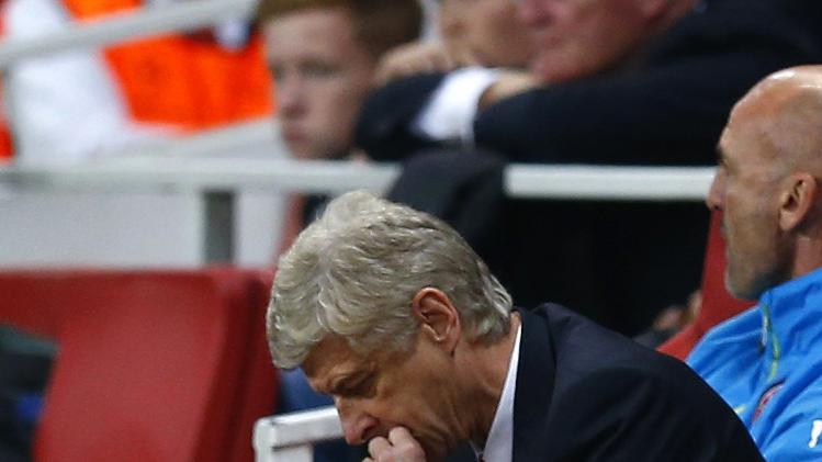 Arsenal manager Wenger reacts during their Champions League playoff soccer match against Besiktas at the Emirates stadium in London