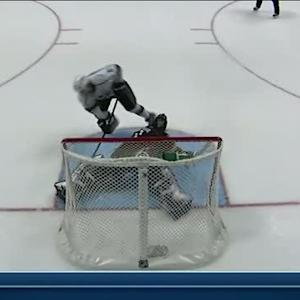 Jonas Hiller sprawls and stops Doughty