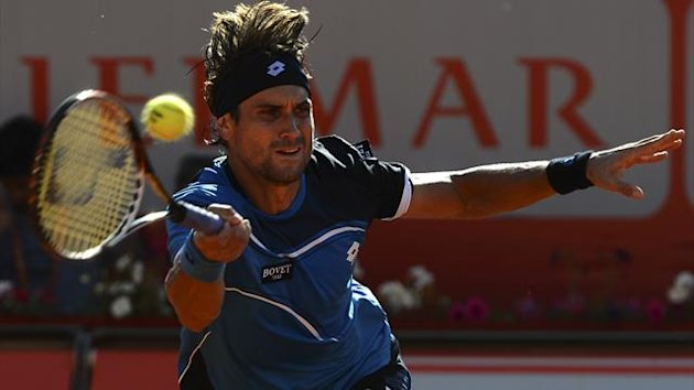 Spanish player David Ferrer returns a ball during the Portugal Open tennis tournament men's singles semi-final match against Italian player Andreas Seppi in Oeiras on May 4, 2013. (AFP)