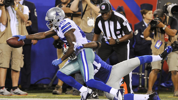 Dallas Cowboys wide receiver Kevin Ogletree (85) scores a touchdown as New York Giants strong safety Kenny Phillips (21) defends during the second half of an NFL football game, Wednesday, Sept. 5, 2012, in East Rutherford, N.J. (AP Photo/Bill Kostroun)