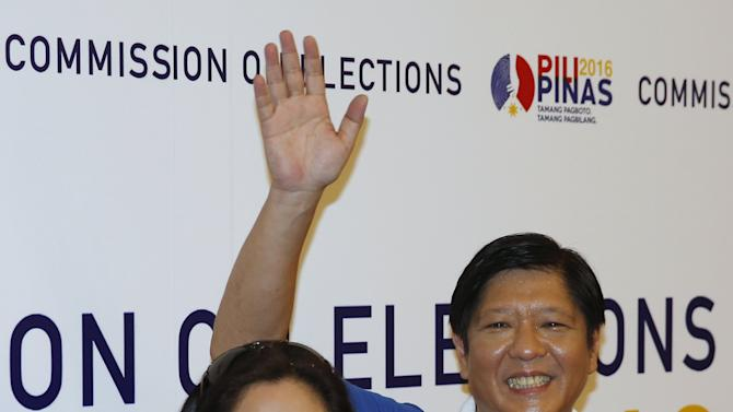 BongBong Marcos waves to the media at the Commission on Elections in Manila