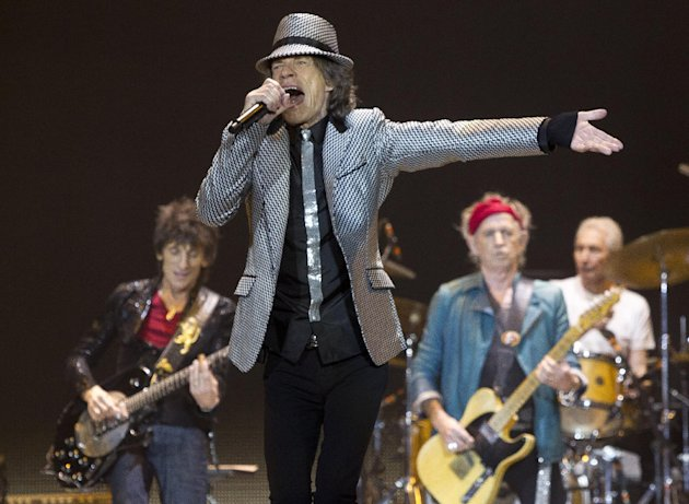 Mick Jagger, front centre,  Ronnie Wood, left, with Keith Richards and Charlie Watts, right, of The Rolling Stones perform at the O2 arena in east London, Sunday, Nov. 25, 2012. The band are playing f