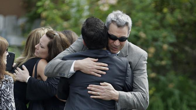 """Mourners embrace outside of Robert Spearing Funeral Home for a private viewing for actor James Gandolfini, Wednesday, June 26, 2013, in Park Ridge, N.J. Gandolfini, who played Tony Soprano in the HBO show """"The Sopranos"""", died while vacationing in Italy last week. (AP Photo/Julio Cortez)"""
