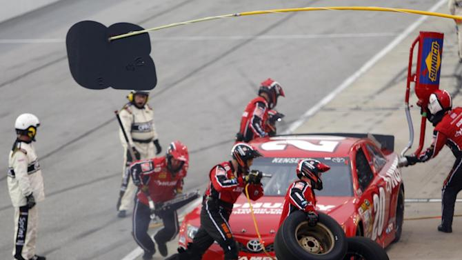 Matt Kenseth makes his first pit stop during the NASCAR Sprint Cup series auto race at Darlington Raceway, Saturday, May 11, 2013, in Darlington, S.C.  (AP Photo/Mic Smith)