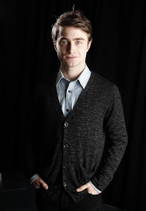 "In this Jan. 6, 2012 photo, actor Daniel Radcliffe poses for a portrait in New York. Radcliffe stars in the upcoming film ""The Woman In Black.""   (AP Photo/Carlo Allegri)"
