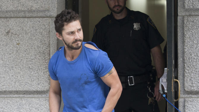 "Actor Shia LaBeouf leaves Midtown Community Court after being arrested the previous day for yelling obscenities at the Broadway show ""Cabaret,"" Friday, June 27, 2014, in New York. The 28-year-old star of the ""Transformers"" franchise faces charges that include disorderly conduct and criminal trespass. (AP Photo/John Minchillo)"