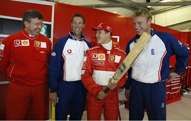 SILVERSTONE - JULY 5:  (l to r) Ross Brawn, Marcus Trescothick, Michael Schumacher and Andrew Flintoff after first practice for the British Grand Prix at Silverstone on July 5, 2002 at Silverstone Cir