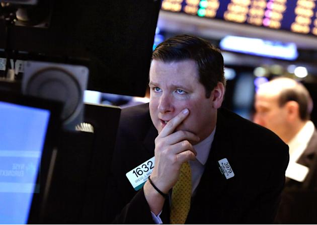 FILE - In this Monday, March 3, 2014, file photo, specialist Gregg Maloney works on the floor of the New York Stock Exchange. Despite fiscal deadlock in Washington that pushed the U.S. to the brink of