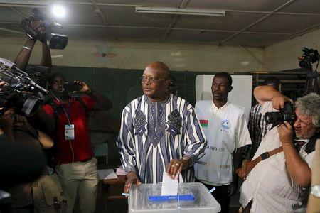 Kabore votes during the presidential and legislative election at a polling station in Ouagadougou