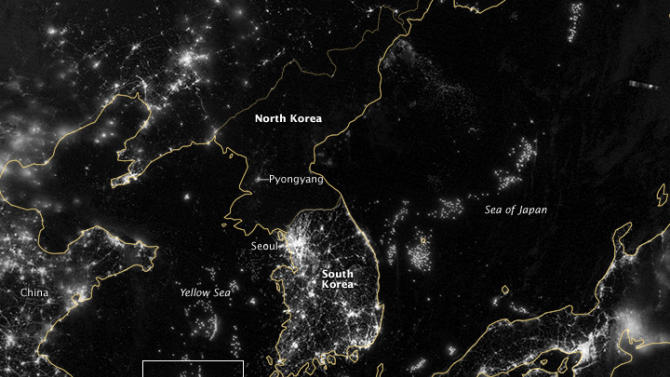"In this image from Sept. 24, 2012 provided by NASA, the Korean Peninsula is seen at night from a composite assembled from data acquired by the Suomi NPP satellite. The image was made possible by the new satellite's ""day-night band"" of the Visible Infrared Imaging Radiometer Suite (VIIRS), which detects light in a range of wavelengths from green to near-infrared and uses filtering techniques to observe dim signals such as city lights, gas flares, auroras, wildfires, and reflected moonlight.  City lights at night are a fairly reliable indicator of where people live. But this isn't always the case, and the Korean Peninsula shows why. As of July 2012, South Korea's population was estimated at roughly 49 million people, and North Korea's population was estimated at about half that number. But where South Korea is gleaming with city lights, North Korea has hardly any lights at all, just a faint glimmer around Pyongyang. The wide-area image shows the Korean Peninsula, parts of China and Japan, the Yellow Sea, and the Sea of Japan. The white inset box encloses an area showing ship lights in the Yellow Sea. Many of the ships form a line, as if assembling along a watery border. (AP Photo/NASA)"
