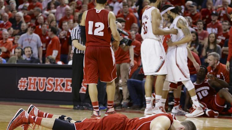 Wisconsin's Josh Gasser (21) lies on the court after a fall in the second half of an NCAA college basketball game in Lincoln, Neb., Sunday, March 9, 2014. Nebraska won 77-68. (AP Photo/Nati Harnik)