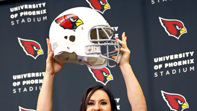 Arizona Cardinals training camp coach Dr. Jen Welter poses for photographers after being introduced, Tuesday, July 28, 2015, at the teams' training facility in Tempe, Ariz. Welter is believed to be the first female to hold a coaching position of any kind in the NFL and will be member of the Cardinals coaching staff throughout training camp and the preseason, working with inside linebackers. (AP Photo/Matt York)