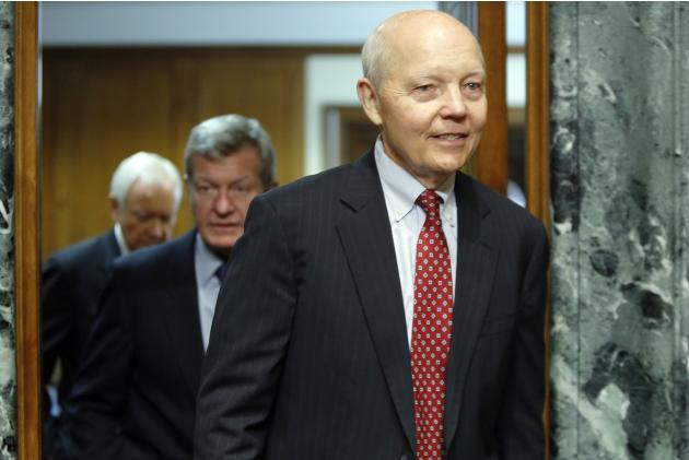 Koskinen returns from a break with Baucus and Hatch to resume testimony before a Senate Finance Committee confirmation hearing on his nomination to be commissioner of the Internal Revenue Service (IRS
