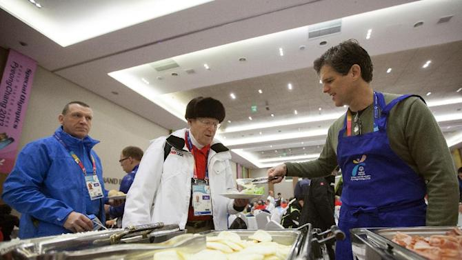 IMAGE DISTRIBUTED FOR SPECIAL OLYMPICS - Timothy Shriver, right, chairman and CEO of Special Olympics, serves food to Special Olympics participants during the 'May I Serve You' event of the 2013 PyeongChang Special Olympics World Winter Games in PyeongChang, S. Korea on the fourth day of the competition, Friday, Feb. 01, 2013. (Seonggwang Kim/AP Images for Special Olympics)