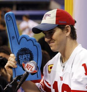 New York Giants quarterback Eli Manning holds up a foam finger during Media Day for NFL football's Super Bowl XLVI Tuesday, Jan. 31, 2012, in Indianapolis. (AP Photo/Eric Gay)