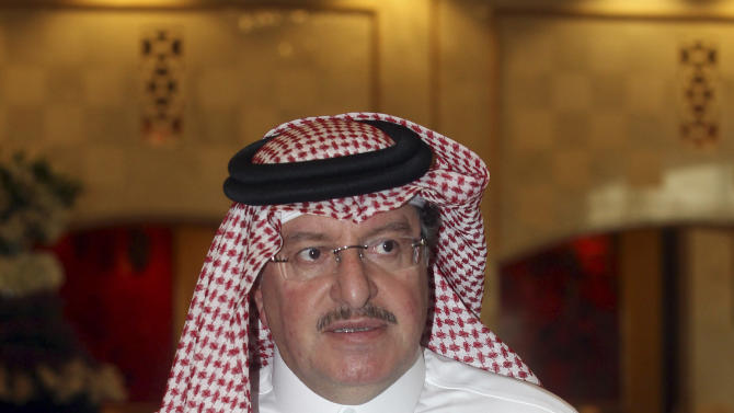 Syrian regime opponent Salem al-Malt attends the Election of the Executive Office of the Syrian National Council in Doha, Qatar, Friday, Nov. 9, 2012. (AP Photo/Osama Faisal)