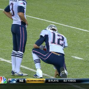 New England Patriots quarterback Tom Brady in as holder for extra point