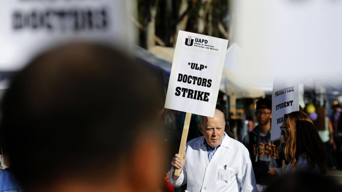 Medical Doctor Steve Cowgill of the University of California San Diego takes part in a one-day unfair labor practices strike as physicians walked off the job in San Diego, California