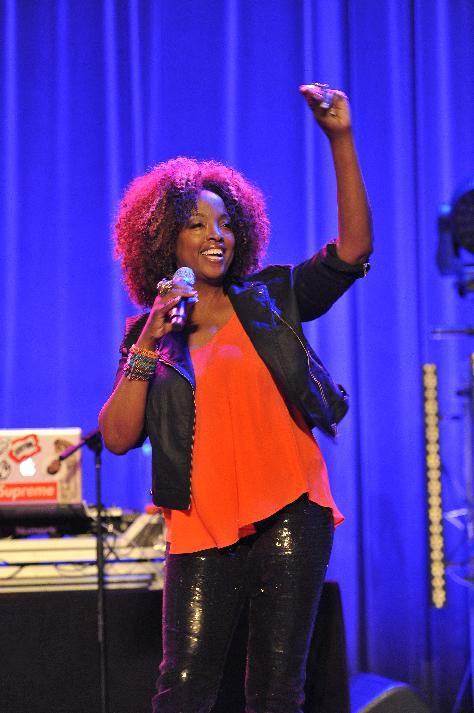 "Entertainer Conya Doss performing at the AIDS Healthcare Foundation's ""Keep The Promise On AIDS"" March and Rally, on Saturday, May 11, 2013 in Cleveland, Ohio. (David Richard /AP Images for AIDS Healthcare Foundation)"