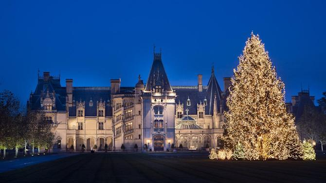 This Thursday, Nov. 15, 2012 photo provided by The Biltmore Company in Asheville, N.C. , shows a Christmas tree on the front lawn of The Biltmore Estate. The tree was bought from a Tennessee family, who had planted it in their yard 40 years ago. Joseph Gray of Roan Mountain, Tenn., will drive down to The Biltmore Estate with his daughter and two grandchildren Saturday, Nov. 17 to take one last look at that special tree. (AP Photo/The Biltmore Company, Sandra Stambaugh)